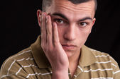 Toothache. Portrait of an teenager with hand over his face — Stock Photo