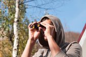 Young man with binoculars watching the nature, Man with binocula — Stock Photo