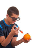 Young teen happy to do experiments with fruits for chemistry lab — Stock Photo