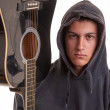 Closeup of a young musician with his acoustic guitar. Selective — Stock Photo #42332047