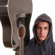 Closeup of a young musician with his acoustic guitar. Selective — Stock Photo #42332055