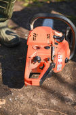 Orange chain saw in the garden. Ready to work — Foto de Stock