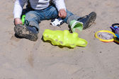 Child on playground in summer park, playing with sand toys — Stock Photo