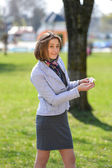 Excited cute woman counts money in the park, happy that she has  — Stock Photo