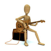 Toy plays electric guitar — Stock Photo