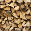 Chopped and stacked pile of pine and birch wood texture background — Stock Photo