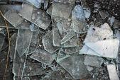Broken glass over grey background. — Stock Photo