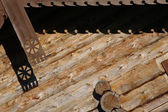 Decorative arnamentom on the house of logs. — Stock Photo