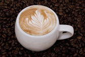 Cappuccino with rosetta — Stock Photo
