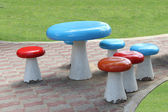 Set of table and chairs on pathway of public lawn — Stock Photo