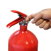 Hand pulling safety pin fire extinguisher isolated over white ba — Stock Photo