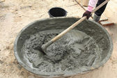 Mixing a cement in salver for applying construction — Stock Photo