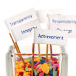 Label of Achievement pin into the glass of colour stone — Stock Photo