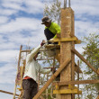 Plaster a cement into a pillar block, A teamwork of worker to c — Stock Photo #33081257