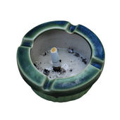 Ceramic ashtray with cigarette on the stone table over white bac — Stock Photo
