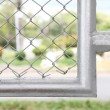 Mesh fence with silver border — Stock Photo