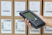Scanning boxes with barcode scanner — Stock Photo