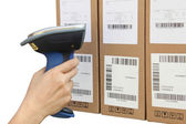 Scanning boxes with buletooth barcode scanner — Stock Photo