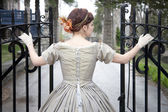 Beautiful woman opening Gate — Stock Photo