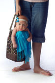 A Tired Mom with Baby Girl in Shopping Bag — Stock Photo