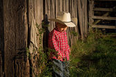 A Young Farmer Boy by his Rustic Wood Barn — Stock Photo