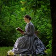Young Woman In Vintage Clothing Reading Outdoors — Foto Stock