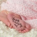 Newborn's Feet — Stock Photo #27284241