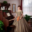 Civil War Historical Woman Standing by Pump Organ — Stock Photo