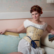 Beautiful Historical Woman Reclines on Couch — Stock Photo
