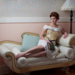 Stock Photo: Elegant Lady on Couch