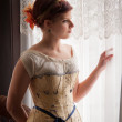 Stock Photo: Elegant Lady in Undergarments Looking out Window