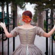 Historical Woman Enters Gate to Mansion — Stock Photo #28319953