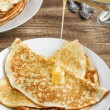 Pancakes with honey — Stock Photo