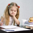 The girl writes on a piece of paper sitting at the table in the image of the writer — Stock Photo #23383220