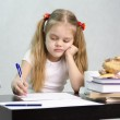 The girl writes on a piece of paper sitting at the table in the image of the writer — Stock Photo #23383262