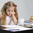The girl writes on a piece of paper sitting at the table in the image of the writer — Stock Photo #23383396