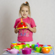 Stock Photo: Girl keeps in hands of maker playing child kitchen utensils