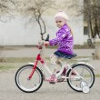 A four year old girl goes on a Bicycle — Stock Photo