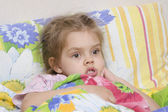 Four-year-old girl is in bed under the blanket — Stock Photo