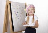 Girl draws on the easel — Stock Photo