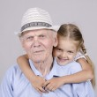 Portrait of an old man eighty years old with a four-year granddaughter — Stock Photo