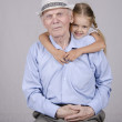 Portrait of an old man eighty years old with a four-year granddaughter — Stock Photo #30061559