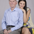 Portrait of an old man eighty years old with twenty years ' granddaughter — Stock Photo