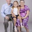 Group portrait: grandmother, grandfather and granddaughter — Stock Photo