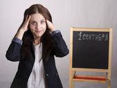 Retrato de un maestro de escuela, se aferra a la cabeza — Foto de Stock