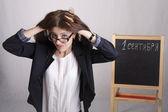 Un maestro de escuela con una mueca, con la cabeza — Foto de Stock
