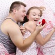 Stock Photo: Young mgives ring girl lying in bed