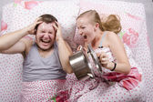 She woke and frightened the boy in the bed, slamming the lid on the pan — Stock Photo