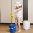 Little girl wash rag in the bucket — Stock Photo