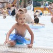 Four-year-old girl gets out of the pool with the terms of — Stock Photo #32957095